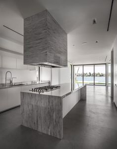 White kitchen countertops and a modern exhaust system