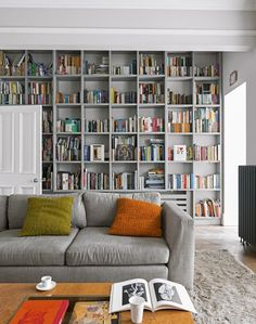 This: We need this! Grey living room with floor to ceiling bookcases.
