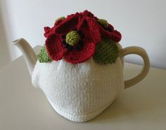 """I was asked by The Wool Bar yarn shop in Worthing to knit my """"Poppies"""" tea cosy design to be part of their window display for Remembrance Day. £1 from each pattern sale at the shop will go to the Royal British Legion."""