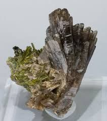 Axinite-(Mn), Ca4Mn2+2Al4[B2Si8O30](OH)2, Epidote,  Canta, Canta Province, Lima Department, Peru.  Copyright © Fabre Minerals. All Rights Reserved  http://www.fabreminerals.com