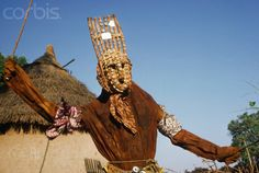 Africa | A Bambara man wears a N'Tomo mask for an initiation ceremony in Mali. | Image and caption © Charles & Josette Lenars