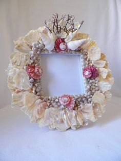 Picture frame with abalone shell pieces by treasuresfromthedeep, $120.00