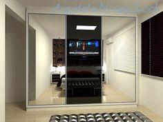 Quarto de casal com papel de parede florido e tv na porta no guarda-roupas | Arquiteta Naiara Loch