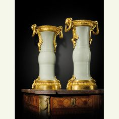 "A pair of important gilt-bronze-mounted Chinese celadon porcelain ""Gu"" vases, Porcelain Qing dynasty, Qianlong period (1736-1795), the mounts late Louis XV, circa 1770. Estimate: 300,000 - 500,000 EUR"