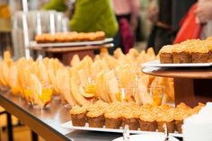 The conference's color theme carried through to snacks served at breaks. Cups of cantaloupe and peaches, cupcakes with orange...