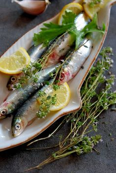 fresh-caught sardines, herbs and lemon.