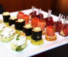 A melange of bright colors, sushi and salmon topped with caviar takes center stage on this beautiful tray of wedding appetizers.