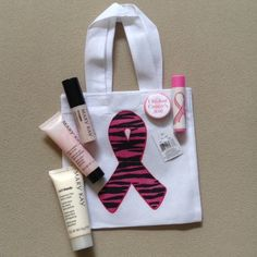 """I Kicked Cancer's A**!  Pink Ribbon Bundle Pink Ribbon mini reusable tote 6.5"""" x 10.5"""" with pin, Chapstick, & Mary Kay deluxe samples as pictured. All items are new. This is part of a fundraiser for my Breast Cancer Awareness team. Mary Kay Makeup Lip Balm & Gloss"""
