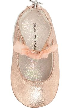 The little one will look darling in these rose gold crib shoes. Sparkly material and a tiny mary-jane strap topped with a pretty bow add girlish flair to any ensemble.