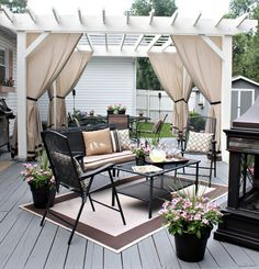 Here is a really captivating back deck décor idea that you can't resist creating in your own home. You will love the way, two separate areas are created and then made complete with elegant finishes, furniture, and fabric. You can also transform your back patio or deck into this cherishing spot.