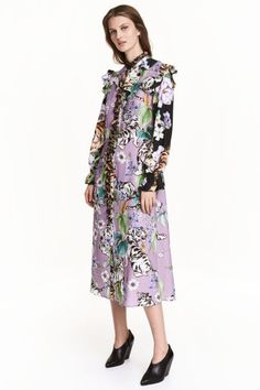 Patterned dress: Calf-length dress in an airy, patterned weave with a small stand-up collar and buttons down the front with a frill-trimmed button band. Frills around the neckline and armholes, long sleeves with smocking and a frill at the cuffs, a seam at the waist and gently flared skirt. Unlined.