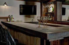 This bar top made of handsome, rough cut lumber looks like something straight out of the Old West. #housetrends