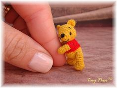 """Winnie The Pooh Bear is 1 ¼"""" tall, made out of tiny crochet stitches with very fine acrylic threads. His body parts are each made separately and then thread jointed. His facial features are carefully embroidered. First in a series. Crochet Amigurumi, Amigurumi Patterns, Crochet Dolls, Knitting Patterns, Crochet Patterns, Cute Crochet, Crochet Crafts, Yarn Crafts, Crochet Projects"""