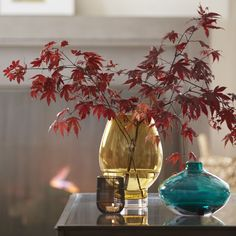 Our amber-colored glass hurricane adds a warm glow to autumnal centerpieces. This beautiful, handmade vessel stands on a clear sham, floating a rounded bowl of gold-toned glass. Created for us exclusively by the skilled artisans at Krosno, a European glass collective dating back to 1923.