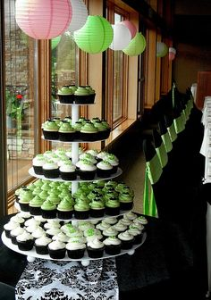 Apple green and white cupcakes in a simple tower display #wedding #weddingcupcakes #cupcaketower #green #cupcakes