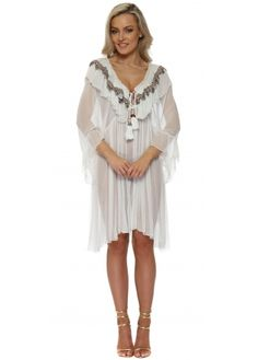 70db4cffa98b4 This Laurie and Joe kaftan dress in white with frills, beaded neckline and  tassel ties is a perfect beach cover up