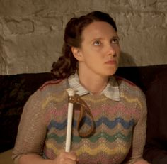 Slightly better close-up of the feather-and-fan sweater.  Isobel Reilly played by Gillian Dean