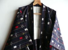 This is a set of a kimono and a haori jacket. Its a traditional winter casual for young women. Its made from a Japanese ikat fabric. 100% wool.
