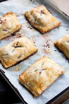 Pie you can eat with your hands? These Rhubarb Hand Pies are filled with tangy rhubarb and surrounded by a flaky sour cream dough. Rhubarb Desserts, Just Desserts, Delicious Desserts, Yummy Food, Rhubarb Pie, Apple Rhubarb Recipes, Mini Desserts, Pie Recipes, Dessert Recipes