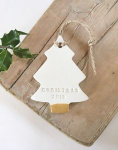 Perfect Christmas gift for baby's first Christmas or newlywed couple. This white clay Christmas tree decoration is hand stamped with 'Christmas and has a gold accent added to base. Ceramic Christmas Decorations, White Christmas Ornaments, Scandinavian Christmas Decorations, Polymer Clay Christmas, Baby Christmas Gifts, Christmas Makes, Noel Christmas, Christmas 2019, Personalised Gifts For Christmas
