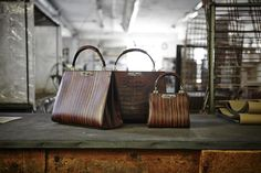 Doriana and Mini Doriana top handle in wood leather and alligator.  From the new #Bertoni1949 women's Collection.
