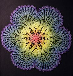 Rainbow Doily 2 by ~rosemaryjayne on deviantART - apparently crocheted out of sewing thread