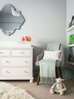 Duck-egg blue is a soothing shade with just the right amount of saturation to add interest to a room without shouting for attention. It suits both genders and can be introduced in layers, like this baseboard and matching blanket, to create a contemporary nursery you won't quickly tire of.