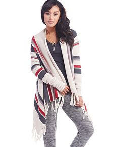 No wardrobe is complete without a little bit of fringe! Rock it on your cardi when you wear this southwestern-inspired sweater, featuring bold stripes in varying sizes, an open front, an asymmetrical fringe hem, and ribbed trim at the wrists. Keep it simple when you toss it on over a relaxed basic tee and pair with destroyed jeans and booties