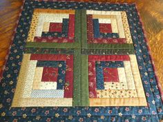 Log Cabin Small Handmade Quilt/Table Topper in warm fabric prints of green, dark red, blue and beige by RubysQuiltShop on Etsy