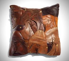 This particular throw pillow has been constructed from used men's shoes, Each piece is unique and hand signed by the artist Baptiste Viry