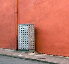 Evol, a Berlin based street artist that transforms city objects miniature buildings using paper.