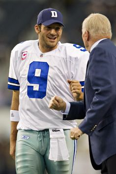 Jerry Jones Photos Photos - Quarterback Tony Romo #9 bumps fist with Owner Jerry Jones of the Dallas Cowboys before a game against the St. Louis Rams at the Cowboy Stadium on October 23, 2011 in Arlington, Texas.  The Cowboys defeated the Rams 34 to 7. - St. Louis Rams v Dallas Cowboys