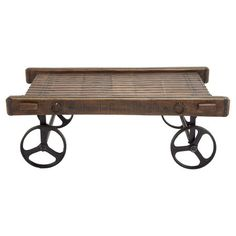 Lend a touch of vintage-chic appeal to your living room or den with this charming coffee table, showcasing a wheeled design and planked wood top.