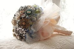 I wrapped Julia's bouquet in cream satin ribbon and cream tulle.