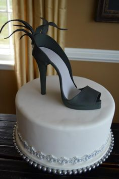 - This is a wedding cake I made for a bride who is obsessed with shoes. The shoe is made from gumpaste.