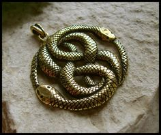 The Auryn-necklace from the Neverending Story-movie would make a great tattoo.