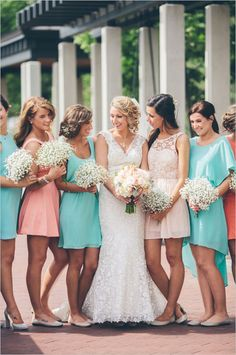 Bright peach and turquoise bridesmaids ideas. #bridesmaids #mismatched #weddingchicks Captured By: Studio127 Photography ---> http://www.weddingchicks.com/2014/04/29/a-wedding-cake-dilemma/