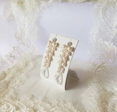 Bridal long chandelier earrings made with Swarovski Elements White Pearls and Crystal Pear.