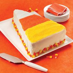 Cut a rectangular cake and add colored sugar crystals or sprinkles to look like candy corn. Love the candy corn pieces at the bottom!