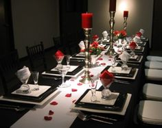 Gorgeous-Black-Red-Dining-Room-Seating-Decorated-with-Red-Candles-and-Red-Flower-Petals-on-Long-Dark-Table.jpg (600×477)