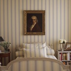 London bedroom in subtle blue & white stripes by Mlinaric, Henry & Zervudachi