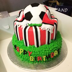 Manchester United colours.. Footy cake