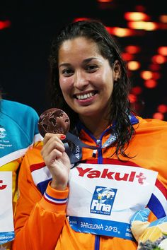 Bronze medal winner Ranomi Kromowidjojo of the Netherlands celebrate on the podium after the Swimming Women's Freestyle 100m Final on day fourteen of the 15th FINA World Championships at Palau Sant Jordi on August 2, 2013 in Barcelona, Spain.