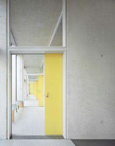 Kindergarten by Ecker Architekten features an austere colour palette and a spiral staircase