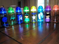 water bottles for my family child care kiddos using bottles from Michaels and my Silhouette Cameo