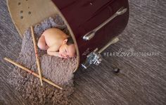 newborn with drums-- From a different angle, but I like the idea of this.