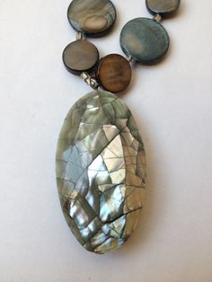 Dragon's Egg: Handmade Necklace Featuring Shell Beads and a Resin Pendant by ReprievesCorner on Etsy