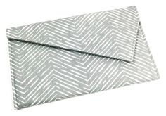 Envelope clutch purse in grey and white herringbone chevron.  This clutch is your perfect everyday errand clutch, for those special occasions, or for a night out with the girls! This clutch is the perfect size for carrying everything you need...your cell phone, lip gloss, wallet, and keys. This envelope clutch also works great as a cosmetic bag, or for keeping those smaller items organized in your larger purse.  Details:  Envelope Clutch is approximately 10 wide x 6 tall.  This clutchs…