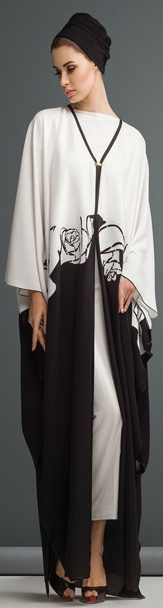 Mauzan abaya Dubai..Work : Big rose lasercut design Fabric : Black + White Crepe