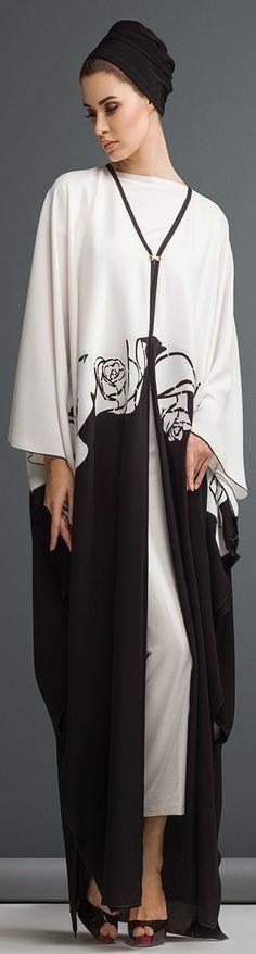 Mauzan abaya Dubai..Work : Big rose lasercut design Fabric : Black + White Crepe